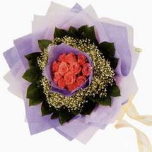 12 adet gül ve elyaflardan   Şırnak çiçekçiler